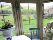 View from Intake Cottage Summerhouse with Swallows Byre beyond garden wall